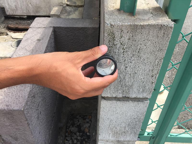 側溝の測量風景補佐